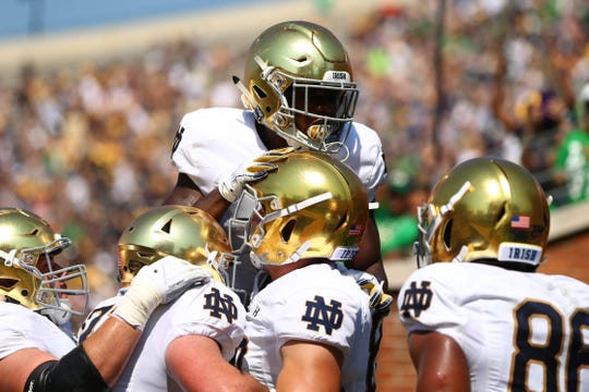 Sep 22, 2018; Winston-Salem, NC, USA; Notre Dame Fighting Irish offense celebrate a touchdown in the second quarter against the Wake Forest Demon Deacons at BB&T Field. Mandatory Credit: Jeremy Brevard-USA TODAY Sports