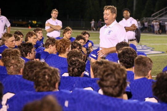 Bishop Chatard's Head Coach Rob Doyle congratulates hit team following their 21 to 13 win of Bishop Chatard vs. Guerin Catholic High School varsity football held at Bishop Chatard High School, September 21, 2018.