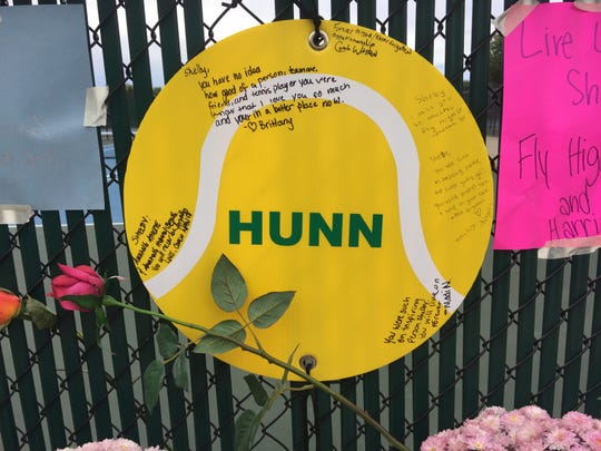 Teammates and friends of Zionsville Middle School student Shelby Hunn left notes at this memorial at the school's tennis courts after Hunn and her brother were found dead Friday in their father's home.