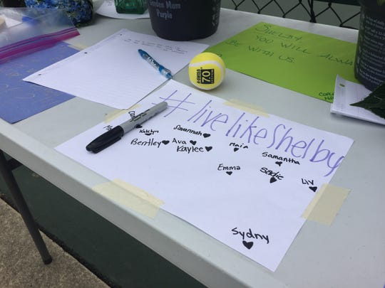 Notes are left outside tennis courts for Shelby Hunn, a Zionsville Middle School student who was found dead in her father's home in what police are calling a double murder-suicide.