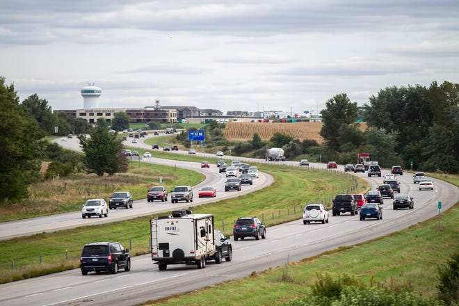 Traffic flows during rush hour near North Liberty on Friday evening, Sept. 21, 2018, along Interstate 380 at mile marker 5.5 southbound.