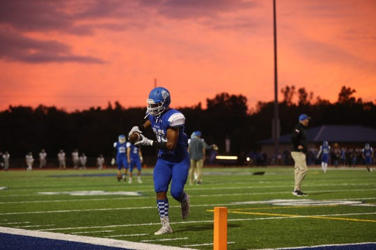 Clear Creek Amana's T.J. Bollers warms up before the Clippers' game against Liberty High in Tiffin on Friday, Sept. 21, 2018.