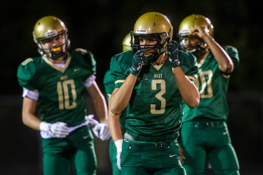 Iowa City West's Justin Thomas (3) adjusts his helmet after taking a hit during a Class 4A varsity football game on Friday, Sept. 21, 2018, at Trojan Field in Iowa City.