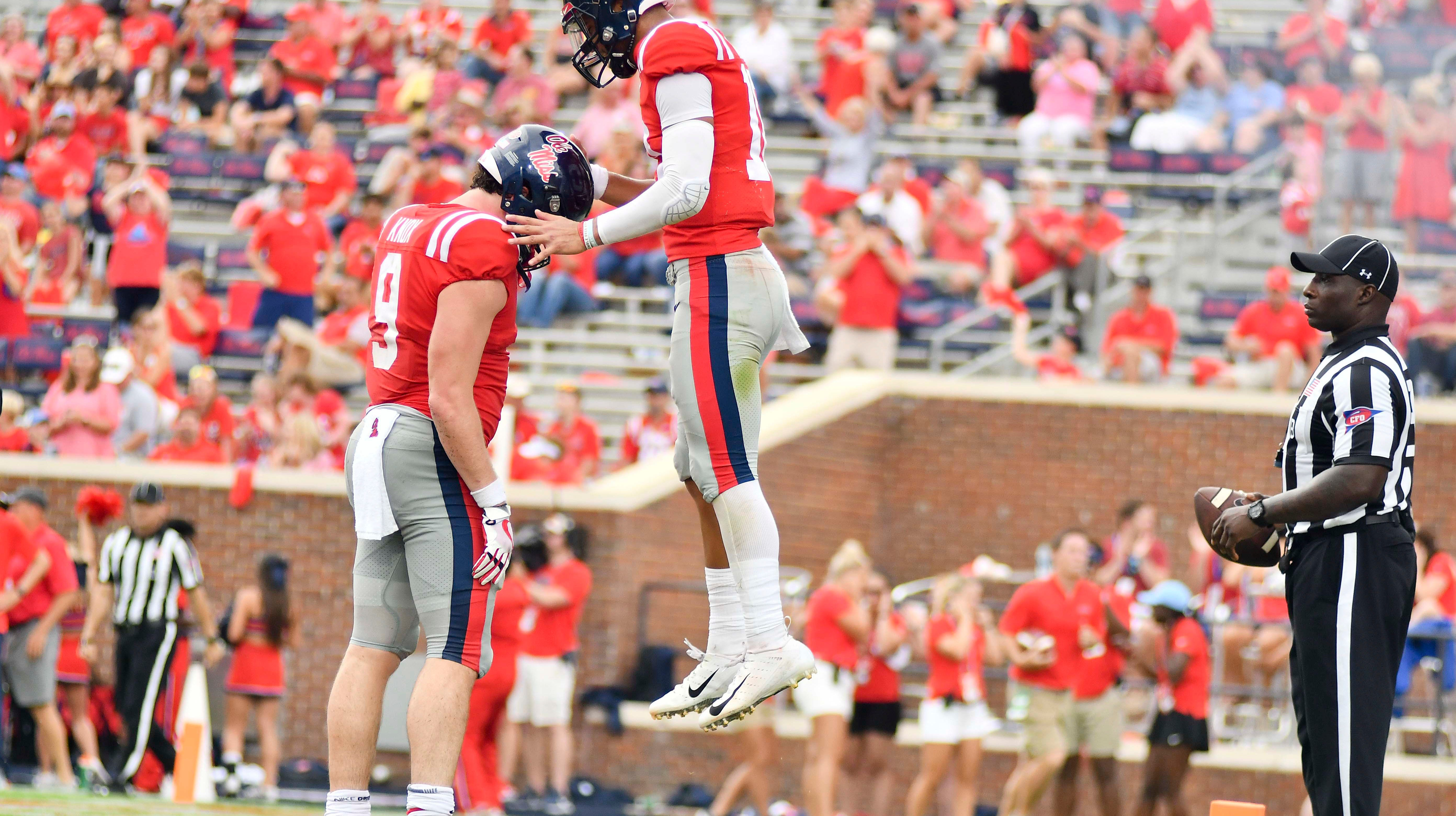 Sep 22, 2018; Oxford, MS, USA; Mississippi Rebels quarterback Jordan Ta'amu (10) reacts with tight end Dawson Knox (9) after a touchdown against the Kent State Golden Flashes during the fourth quarter at Vaught-Hemingway Stadium. Mandatory Credit: Matt Bush-USA TODAY Sports