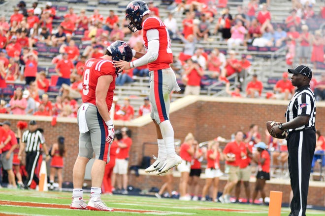 Sep 22, 2018; Oxford, MS, USA; Ole Miss quarterback Jordan Ta'amu (10) reacts with tight end Dawson Knox (9) after a touchdown against the Kent State Golden Flashes during the fourth quarter at Vaught-Hemingway Stadium. Mandatory Credit: Matt Bush-USA TODAY Sports