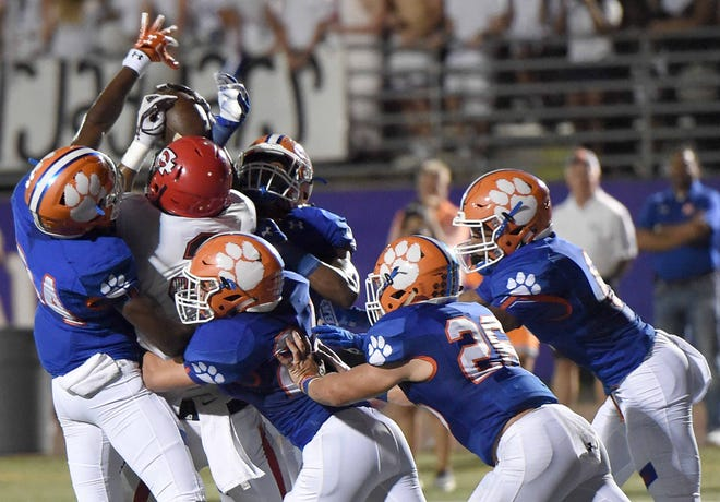 The Madison Central defense stops Clinton's EJai Mason short of the goal line on Friday, September 21, 2018, at Madison Central High School in Madison, Miss.