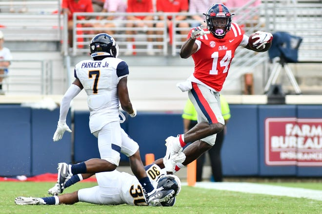 Sep 22, 2018; Oxford, MS, USA; Ole Miss wide receiver D.K. Metcalf (14) is defended by Kent State Golden Flashes cornerback Darryl Marshall (30) and cornerback Jamal Parker (7) during the third quarter at Vaught-Hemingway Stadium. Mandatory Credit: Matt Bush-USA TODAY Sports