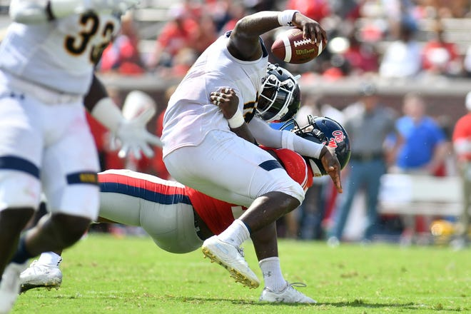 Sep 22, 2018; Oxford, MS, USA; Ole Miss defensive end Markel Winters (19) tackles Kent State Golden Flashes quarterback Woody Barrett (15) during the third quarter at Vaught-Hemingway Stadium. Mandatory Credit: Matt Bush-USA TODAY Sports