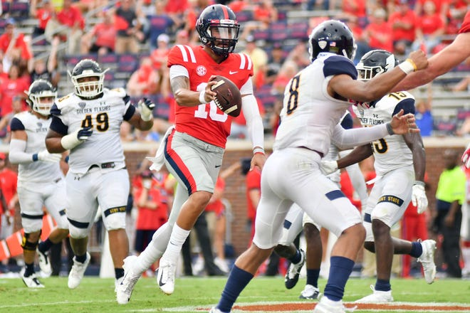 Sep 22, 2018; Oxford, MS, USA; Ole Miss quarterback Jordan Ta'amu (10) runs for a touchdown in the Rebels' 38-17 win over Kent State Saturday at Vaught-Hemingway Stadium. Mandatory Credit: Matt Bush-USA TODAY Sports