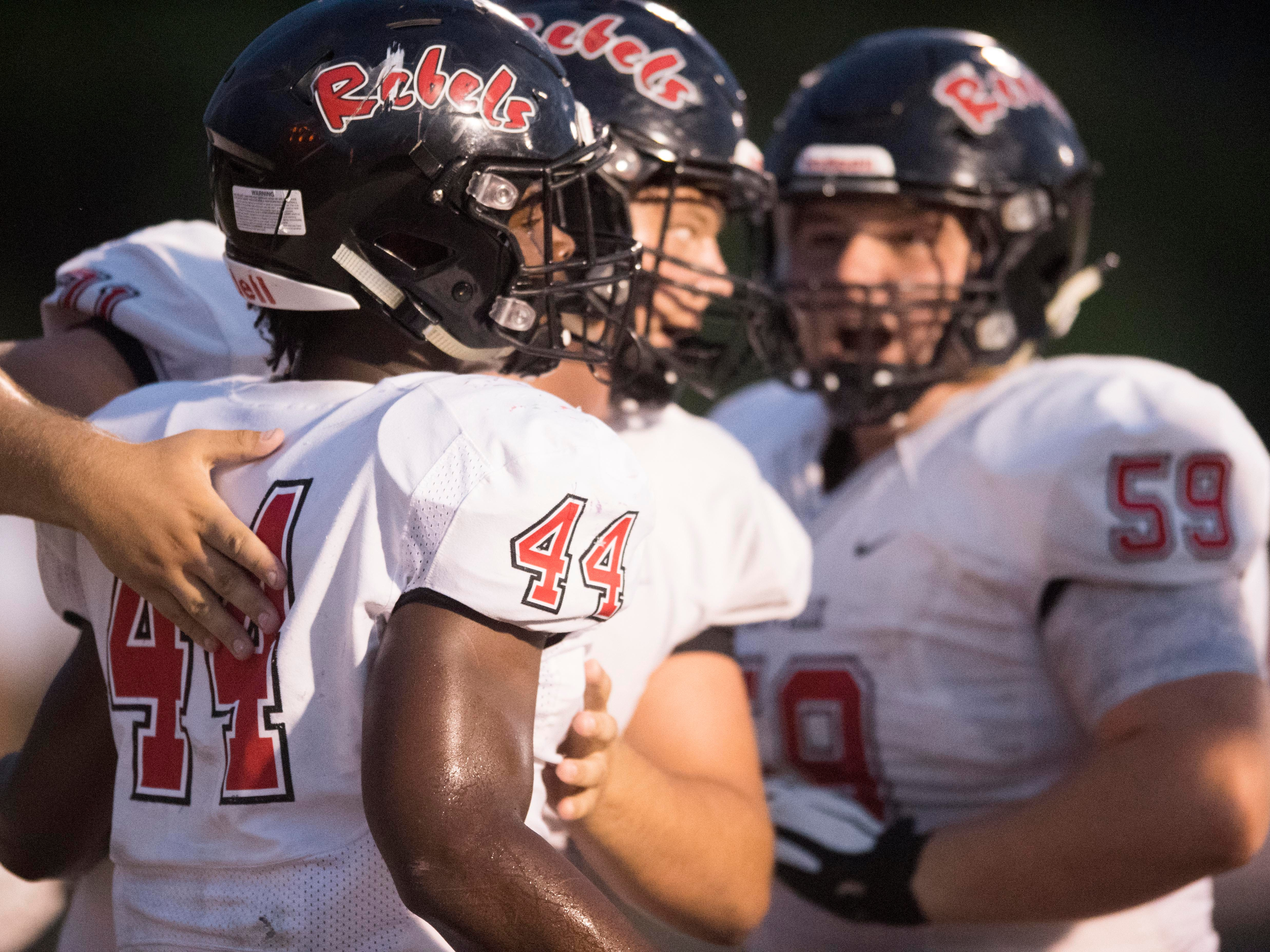 Teammates congratulate Maryville's Tee Hodge (44) after Hodge scored a touchdown in the football game against Fulton on Friday, September 21, 2018.