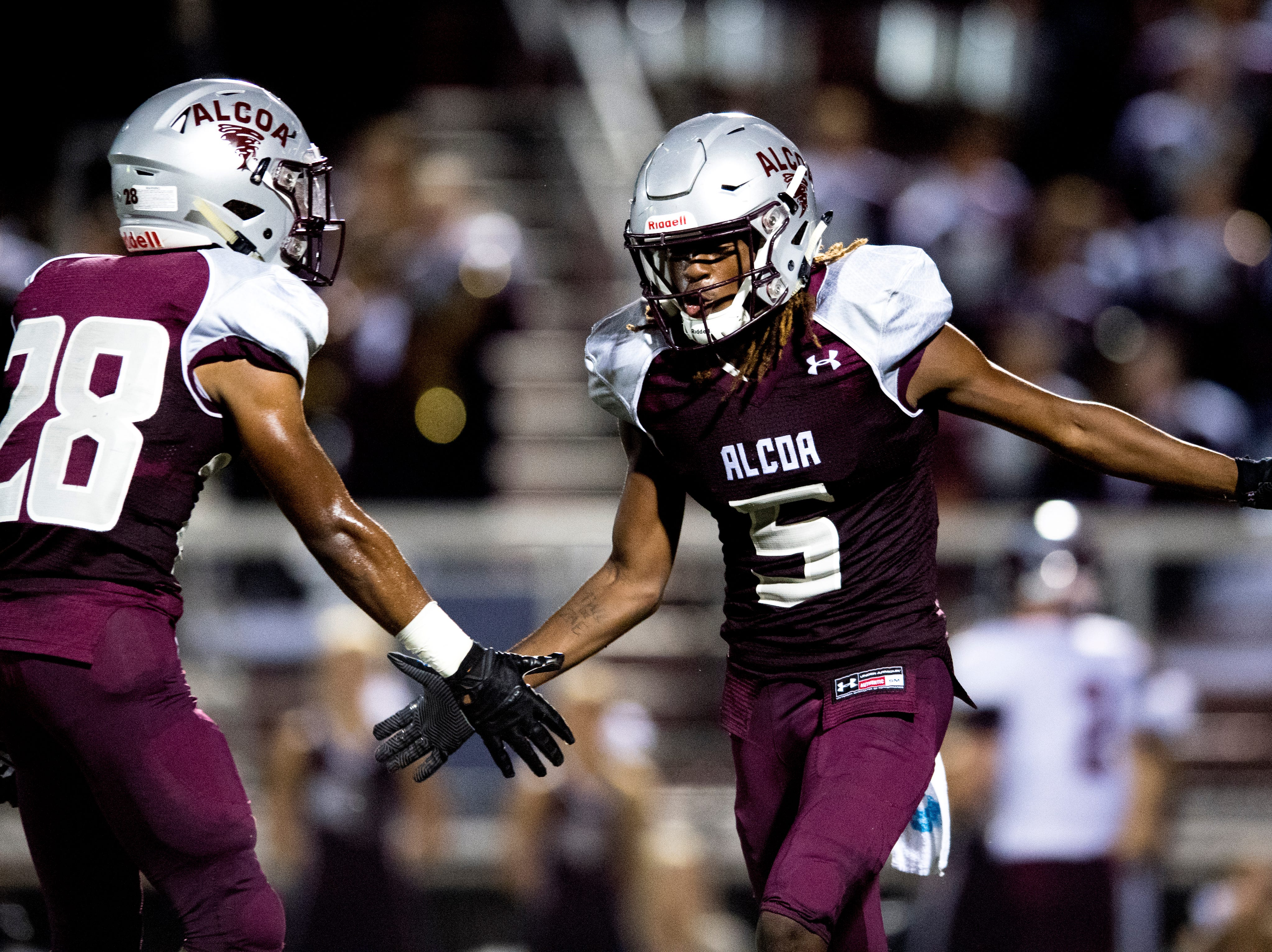 Alcoa's C.J. Armstrong (5) is congratulated by Alcoa's J.R. Jones (28) on a run during a game between Alcoa and Dobyns-Bennett at Alcoa High School in Alcoa, Tennessee on Friday, September 21, 2018.