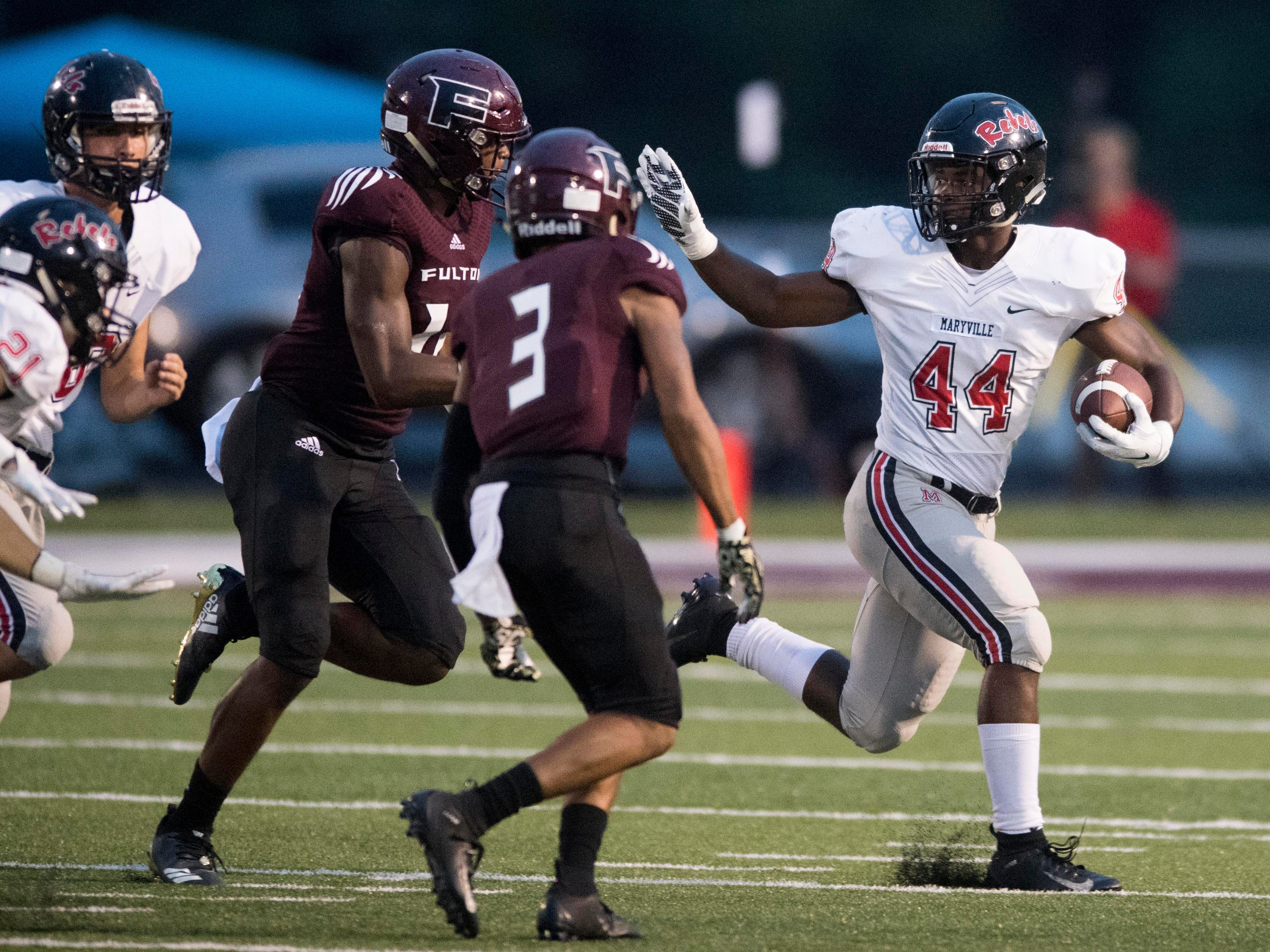 Maryville's Tee Hodge (44) tries to hold off Fulton's J'Coryan Anderson (12) and Shamond Morelan (3) during the football football game at Fulton on Friday, September 21, 2018.