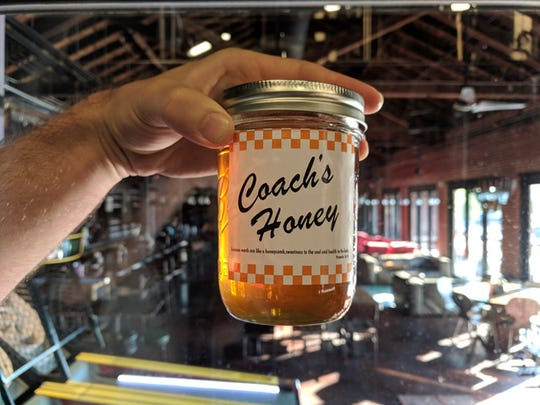 Pictured is a jar of Phillip Fulmer's honey, which Yee-Has used to create the limited edition Coach's Honey Blonde Ale.