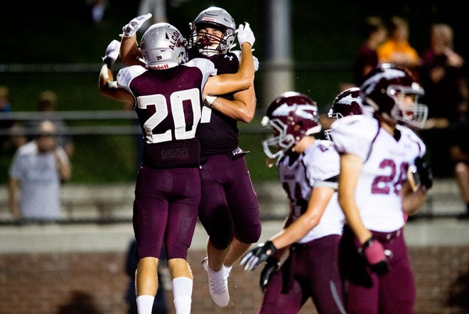 Alcoa's Tyler Boyd (20) is congratulated by Tristen Blakenship (7) on his touchdown during a game between Alcoa and Dobyns-Bennett at Alcoa High School in Alcoa, Tennessee on Friday, September 21, 2018.