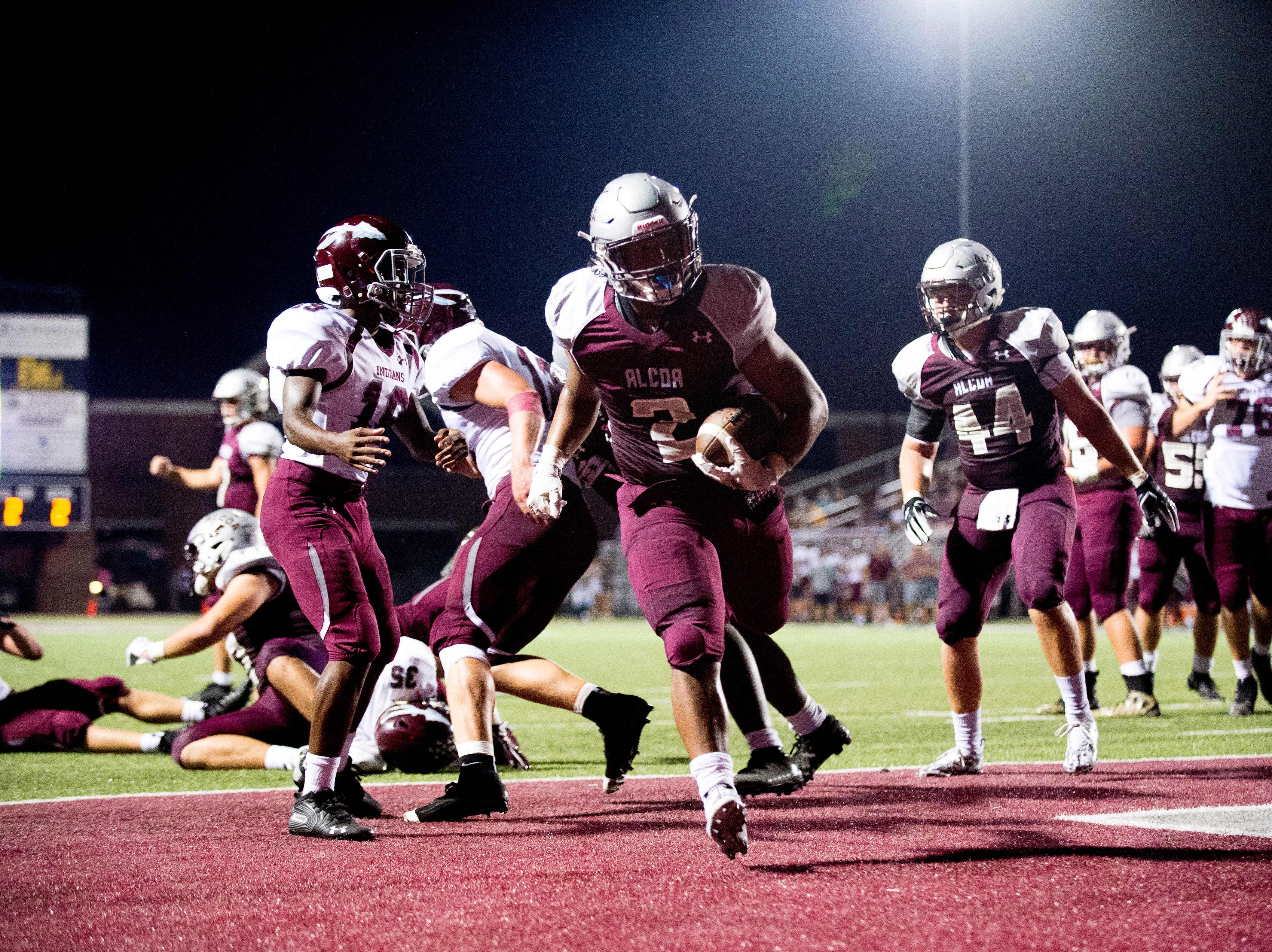 Alcoa's K'Vaughn Tyson (2) scores a touchdown during a game between Alcoa and Dobyns-Bennett at Alcoa High School in Alcoa, Tennessee on Friday, September 21, 2018.
