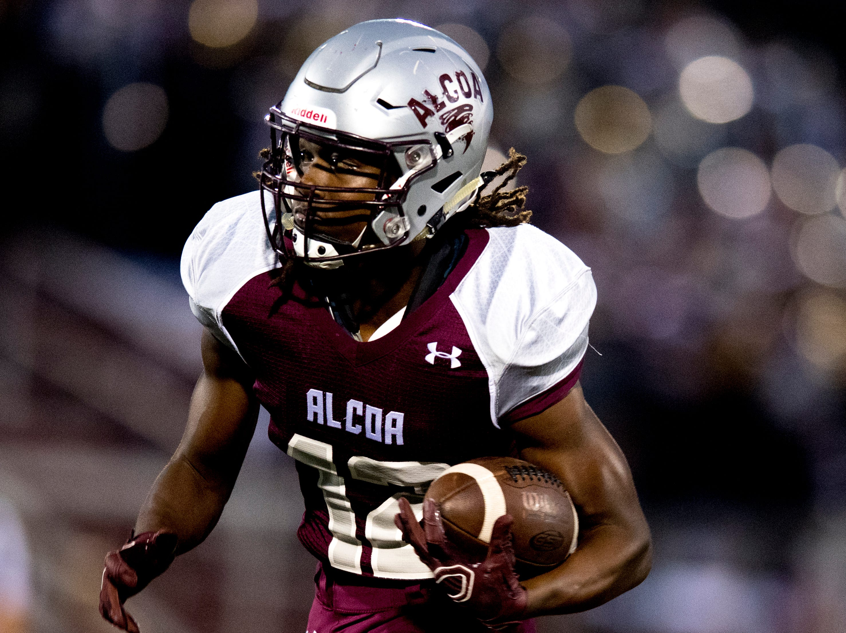 Alcoa's Isiah Cox (12) runs with the ball during a game between Alcoa and Dobyns-Bennett at Alcoa High School in Alcoa, Tennessee on Friday, September 21, 2018.