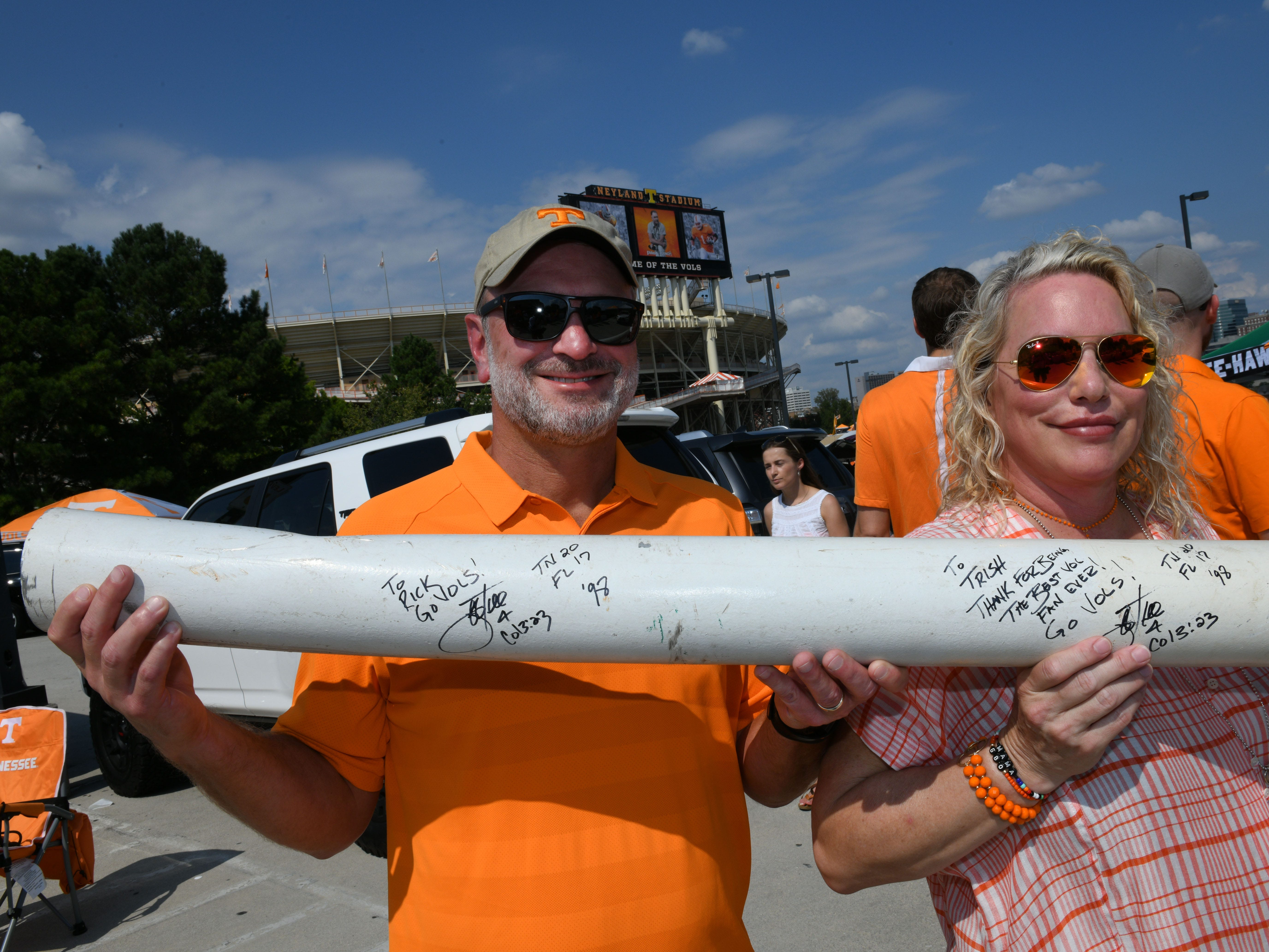 Buzz and Trish Nabers hold their piece of the 1998 goalpost from that TN vs. Fla game at their tailgate before the game against Florida in Neyland Stadium Saturday, September 22, 2018 in Knoxville, Tenn.