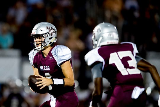 Alcoa's Walker Russell (1) looks to pass as Alcoa's Ronald Jackson (13) defends during a game between Alcoa and Dobyns-Bennett at Alcoa High School in Alcoa, Tennessee on Friday, September 21, 2018.