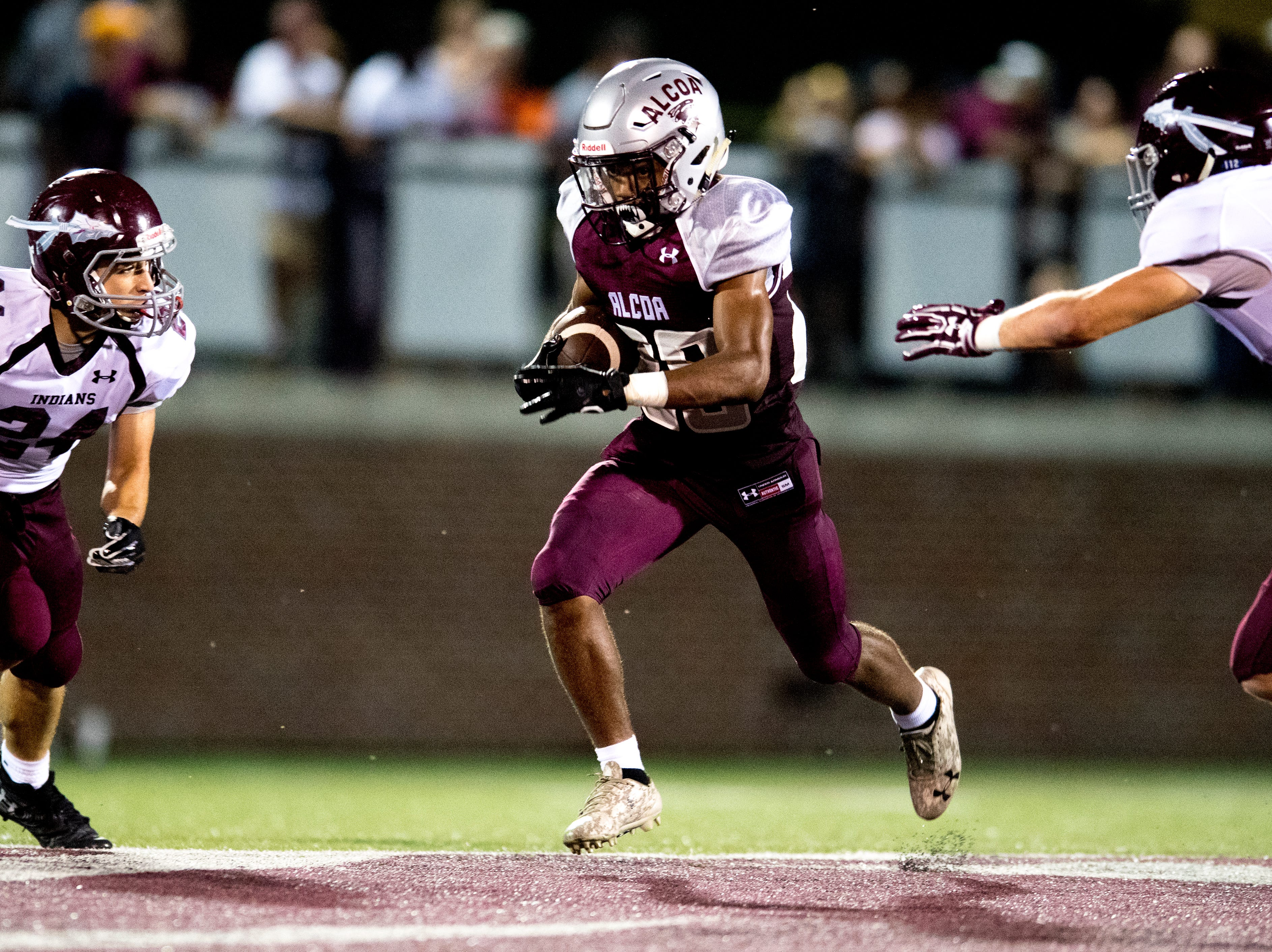 Alcoa's J.R. Jones (28) runs with the ball during a game between Alcoa and Dobyns-Bennett at Alcoa High School in Alcoa, Tennessee on Friday, September 21, 2018.