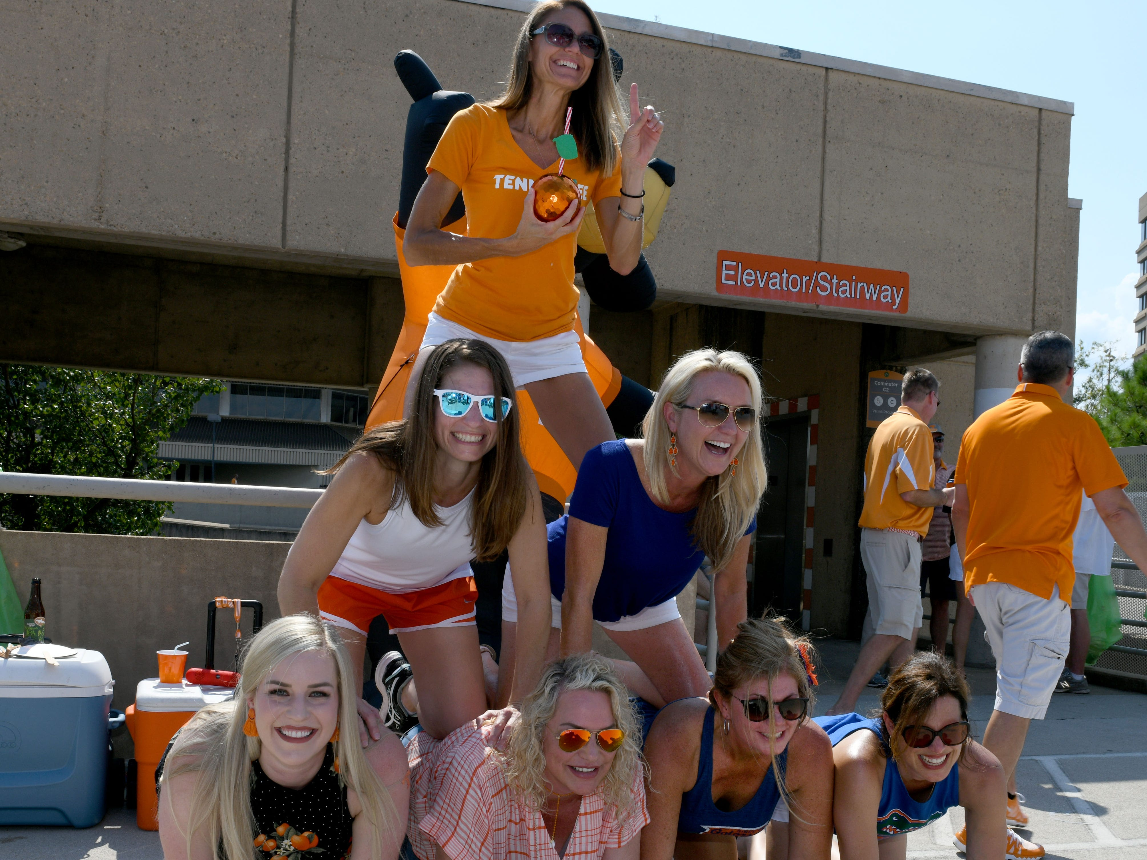 A G10 tailgate group says they form a pyramid each year before the Tennessee vs. Florida game in Neyland Stadium Saturday, September 22, 2018 in Knoxville, Tenn.
