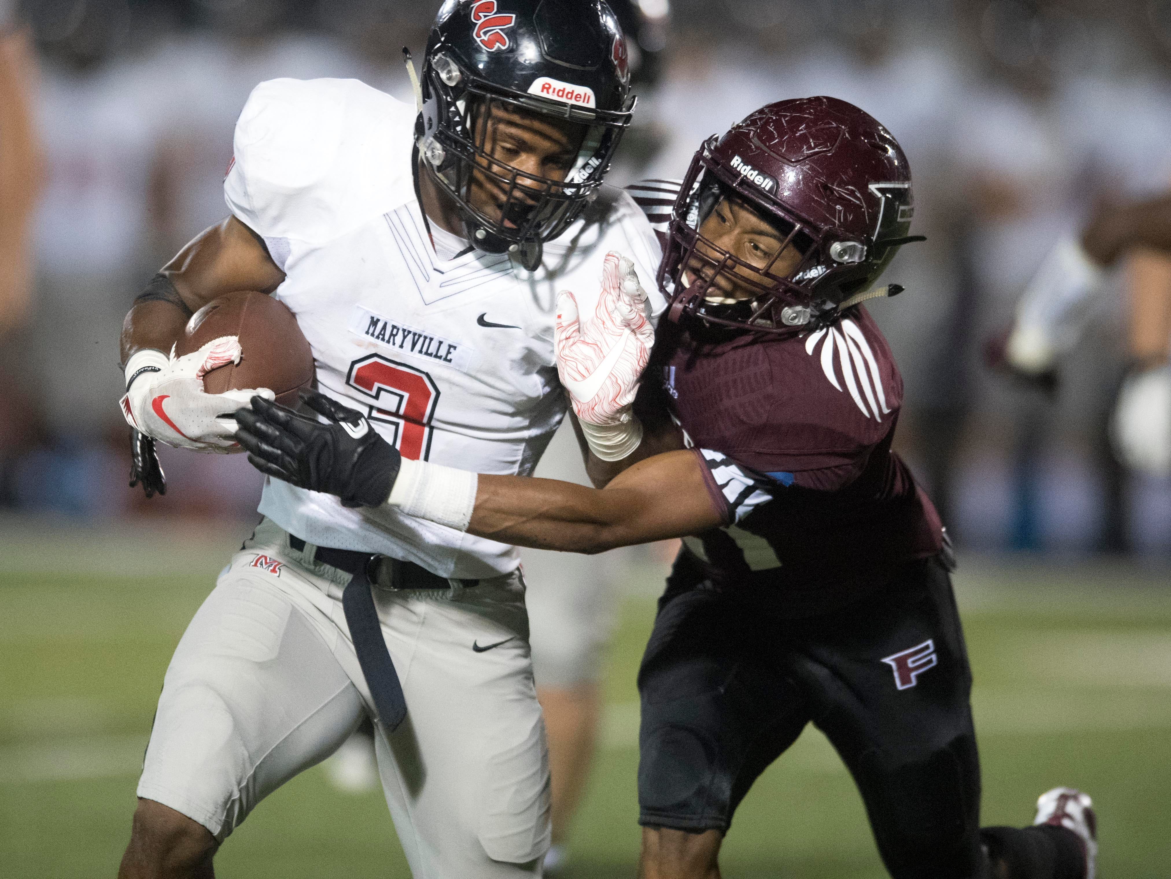 Maryville's A.J. Davis (3) is tackled by Fulton's Kevin Johnson (21) in the football at Fulton on Friday, September 21, 2018.