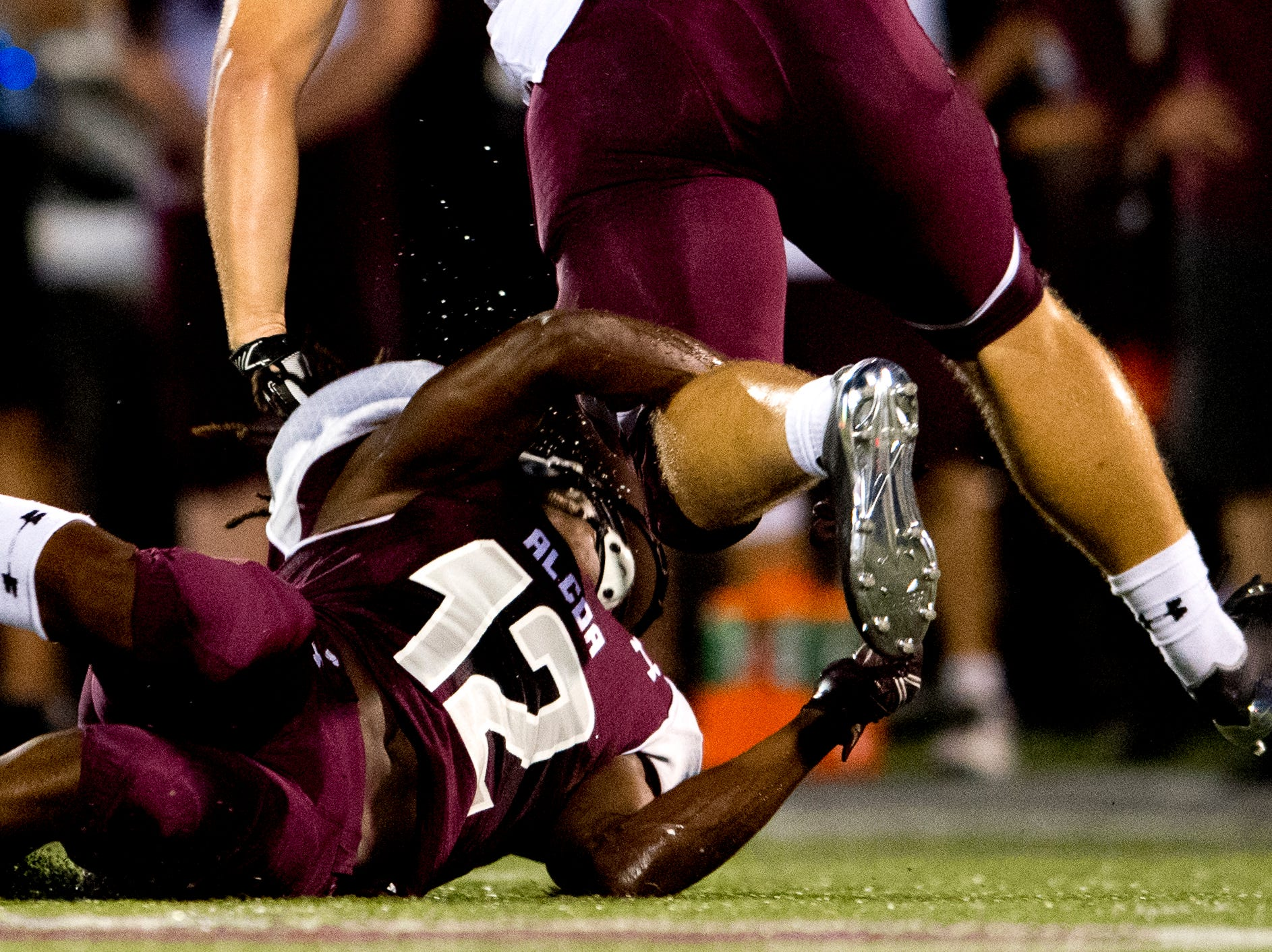 Alcoa's Isiah Cox (12) trips up a Dobyns-Bennett player during a game between Alcoa and Dobyns-Bennett at Alcoa High School in Alcoa, Tennessee on Friday, September 21, 2018.