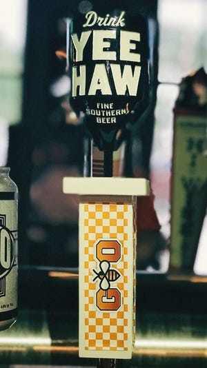 This special tap handle was designed for a new blonde ale made as a collaboration between Yee-Haw Brewing Company and Phillip Fulmer.