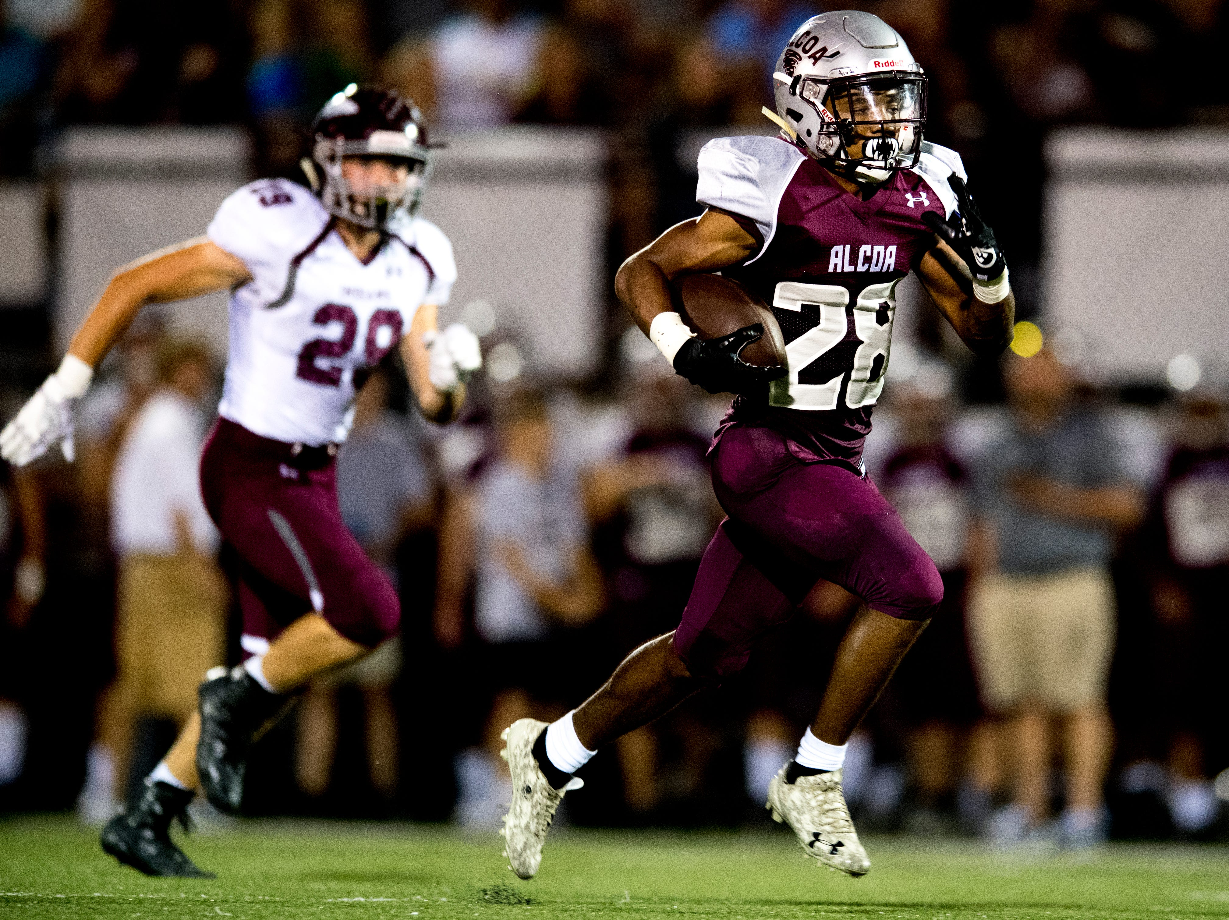 Alcoa's J.R. Jones (28) runs with the ball down the field during a game between Alcoa and Dobyns-Bennett at Alcoa High School in Alcoa, Tennessee on Friday, September 21, 2018.