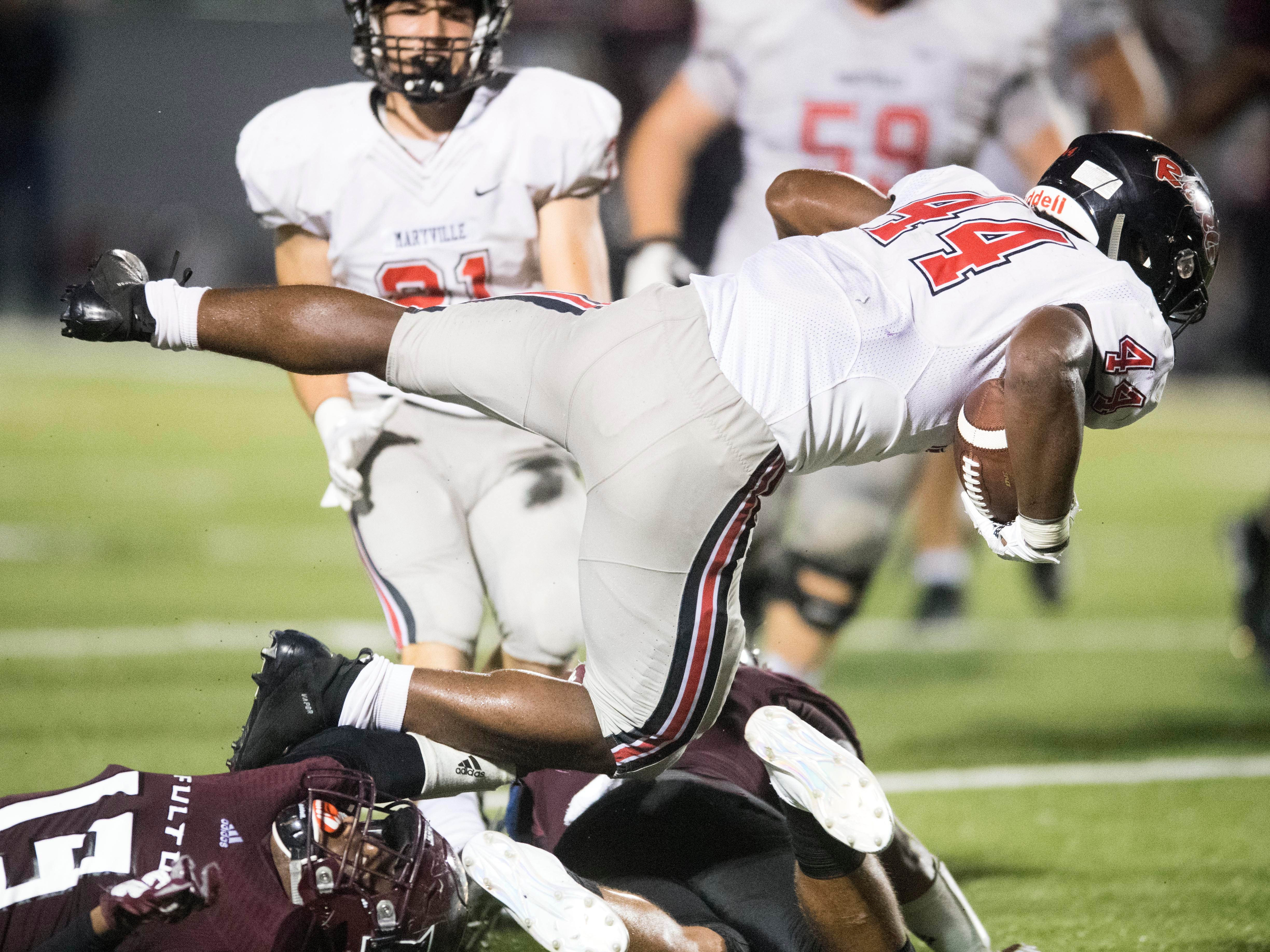 Maryville's Tee Hodge (44) fights for yards in the football game against Fulton on Friday, September 21, 2018.