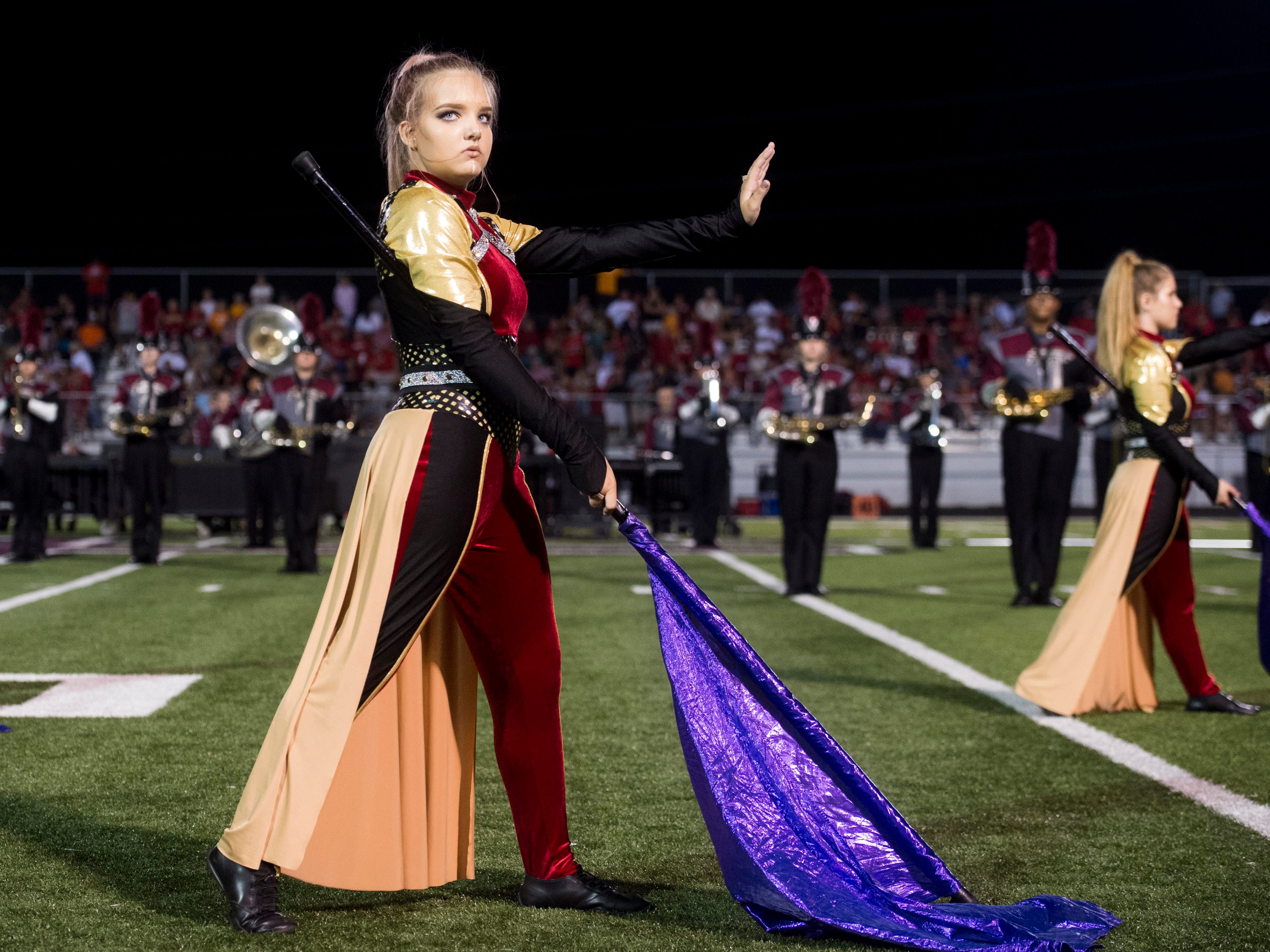 The Fulton High School Band performs at halftime in the football game between Maryville and Fulton on Friday, September 21, 2018. The theme of their show Wakanda Forever.