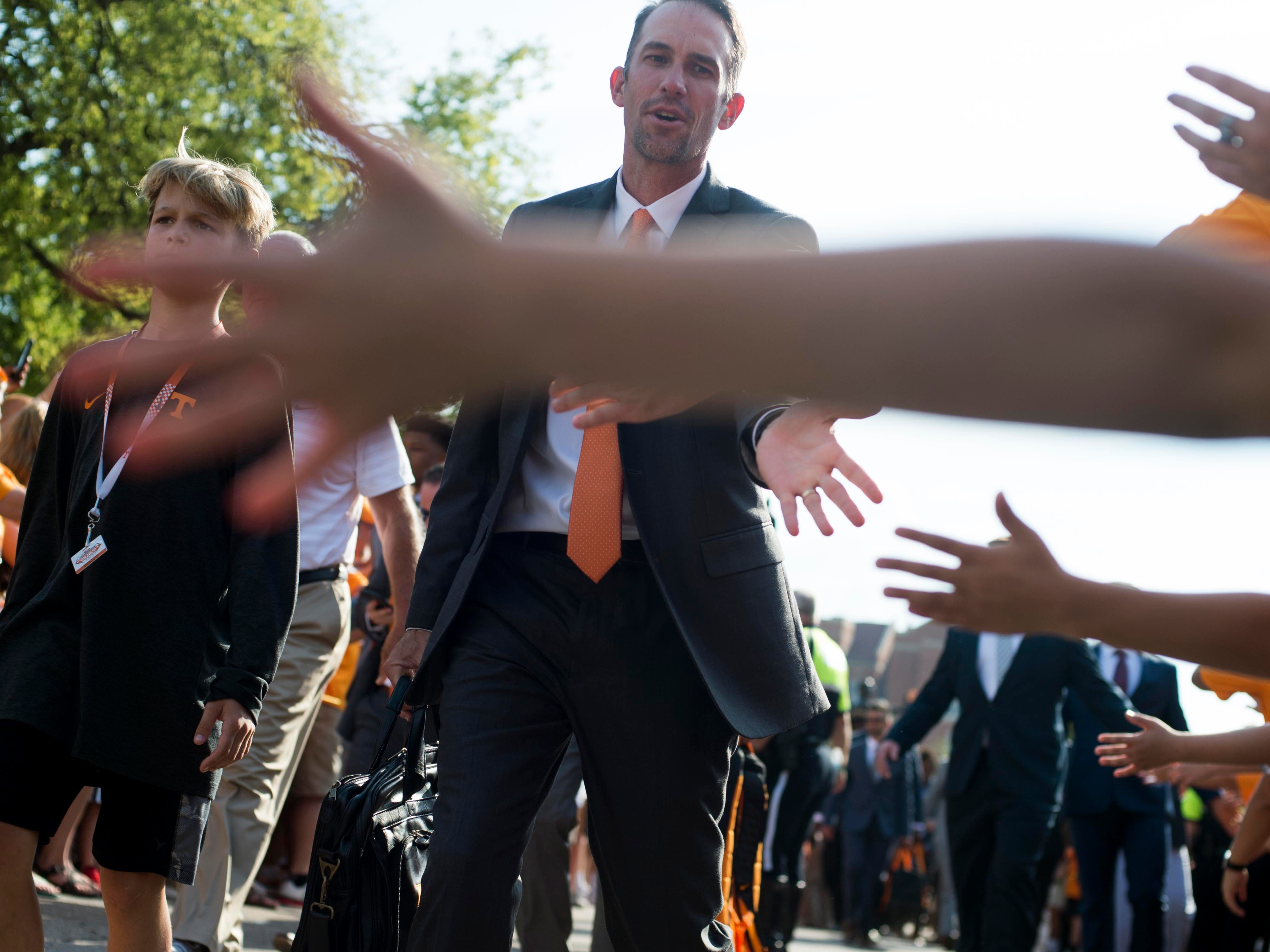 Tennessee Offensive Coordinator and Quarterbacks coach Tyson Helton greet fans on the Vol Walk on Saturday, September 22, 2018.