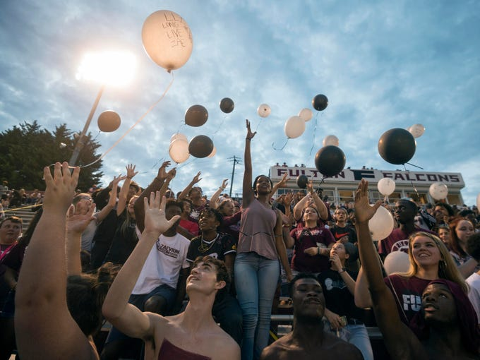 Fulton students release balloons into the air in honor of Zaevion Dobson before the start the football game against Maryville on Friday, September 21, 2018.