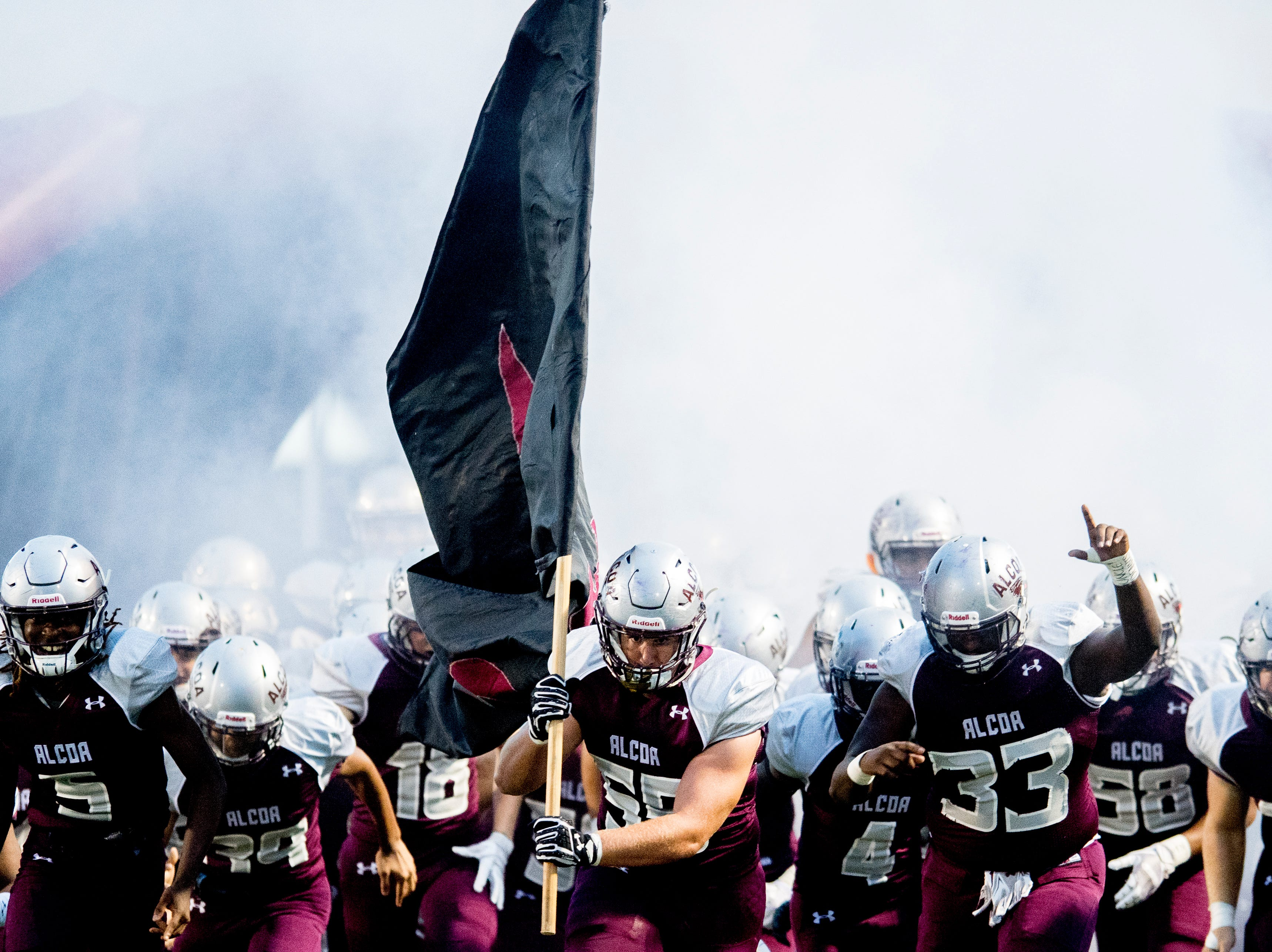 Alcoa storms the field during a game between Alcoa and Dobyns-Bennett at Alcoa High School in Alcoa, Tennessee on Friday, September 21, 2018.