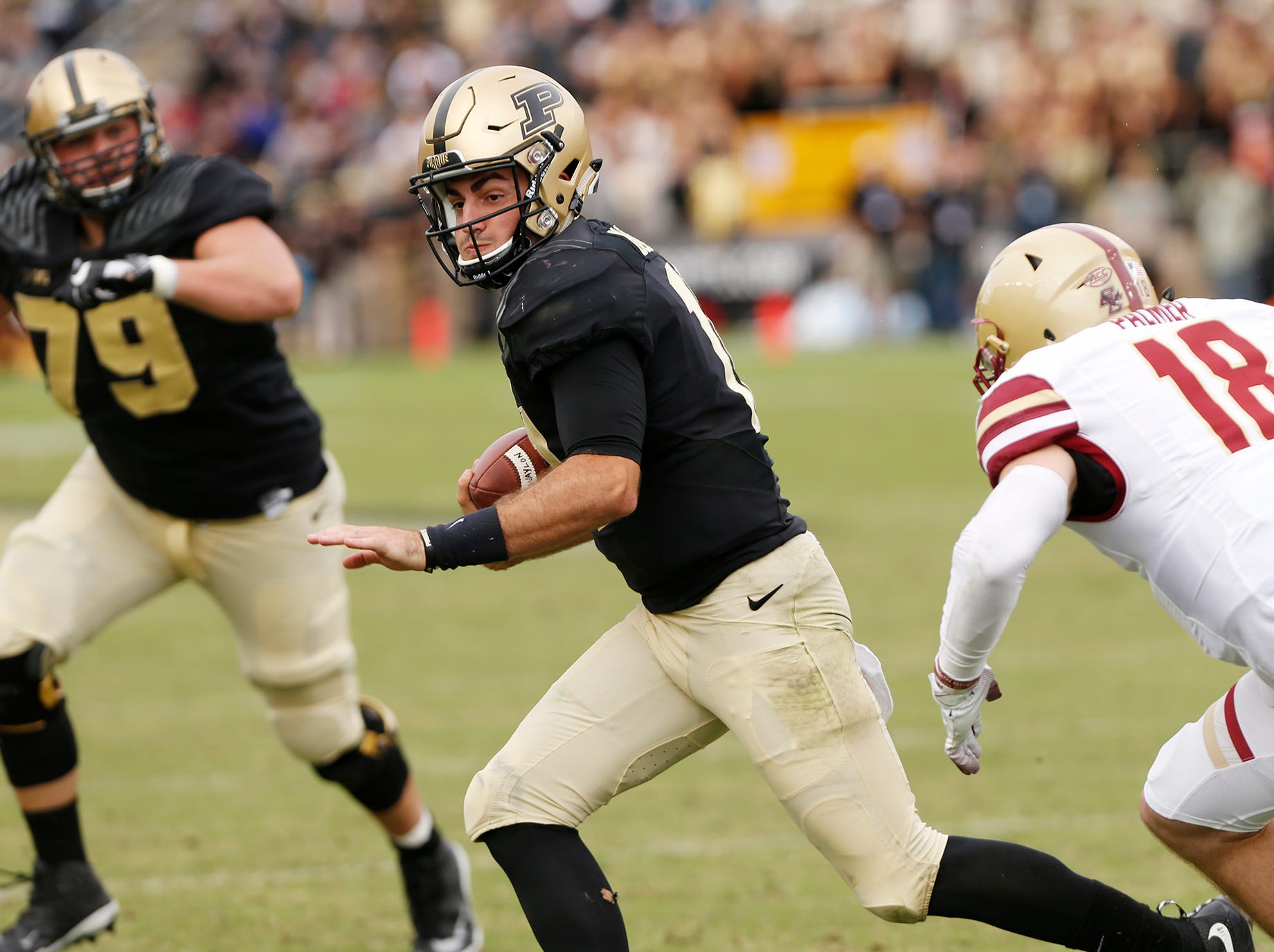 David Blough with a second half carry against Boston College Saturday, September 22, 2018, in Ross-Ade Stadium. Purdue defeated Boston College 30-13.