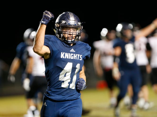 Grant Kennedy pumps his fist after Central Catholic forced Rensselaer to turn the ball over on downs late in the fourth quarter of the Knights' 26-21 victory earlier this season.