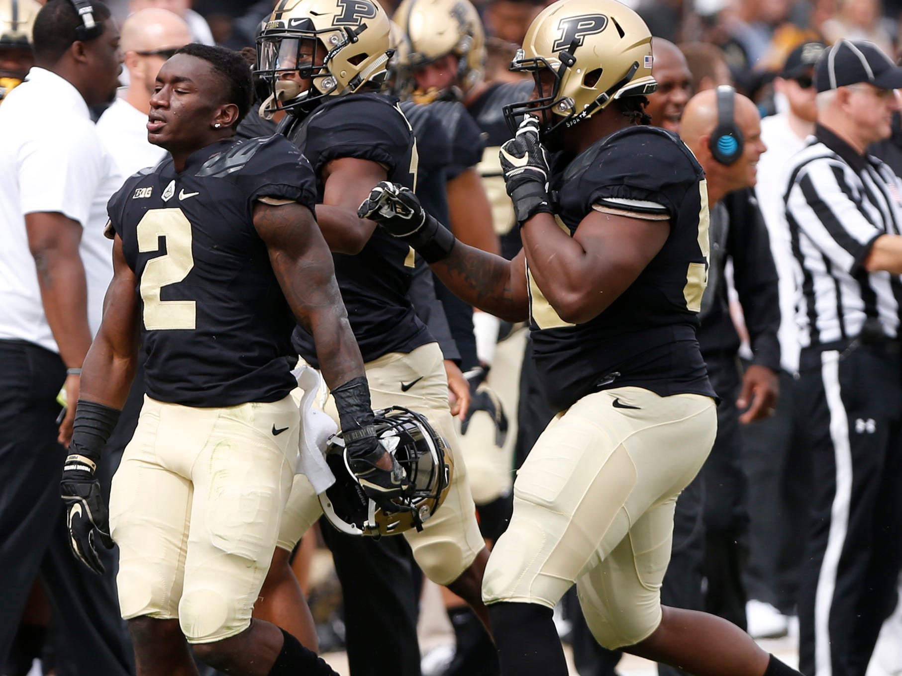 Kenneth Major, left, of Purdue celebrates with teammates after his second half interception against Boston College Saturday, September 22, 2018, in Ross-Ade Stadium. Purdue defeated Boston College 30-13.
