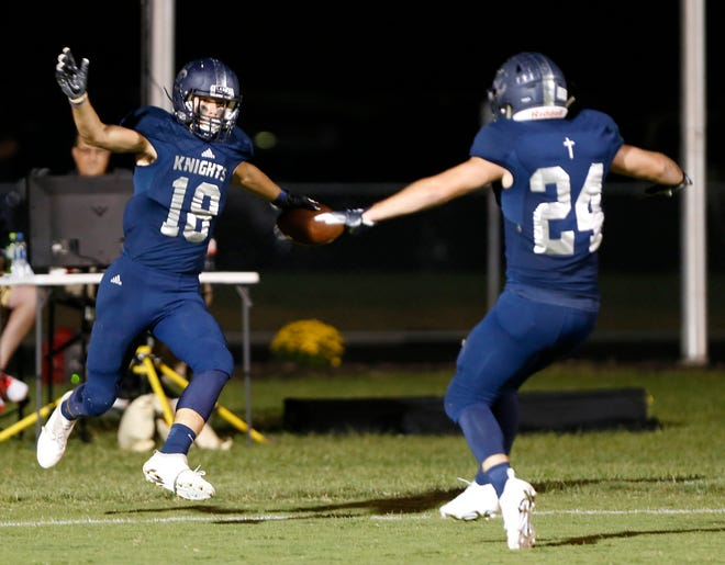 Karson Kyhnell, left, of Central Catholic celebrates with Adam Dienhart after his pass reception for a touchdown against Rensselaer in the second half Friday, September 21, 2018, in Lafayette. CC defeated Rensselaer 26-21.