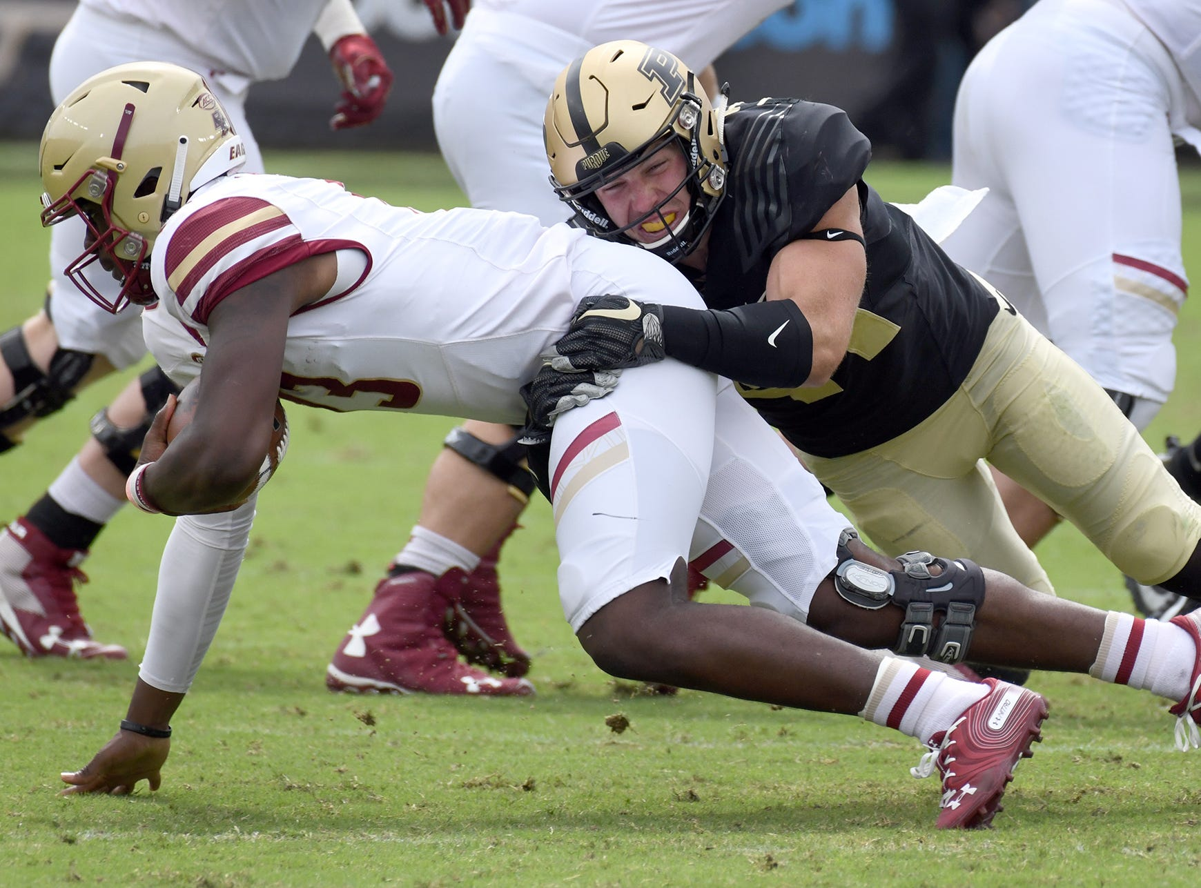 Purdue's Jacob Thieneman sacks BC quarterback Anthony Brown in Purdue's 30-13 win in West Lafayette on Saturday September 22, 2018.