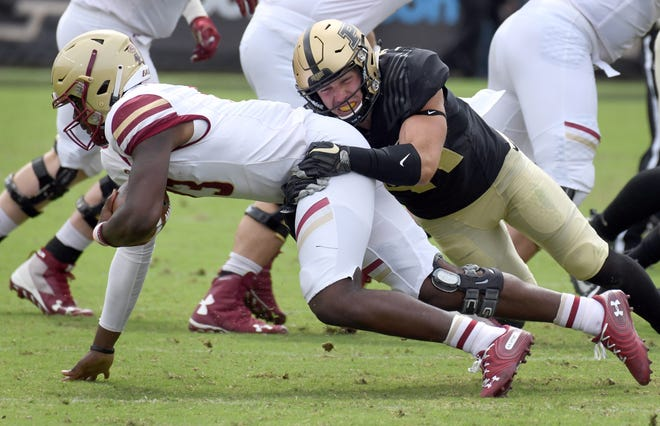 Purdue safety Jacob Thieneman sacks BC quarterback Anthony Brown.