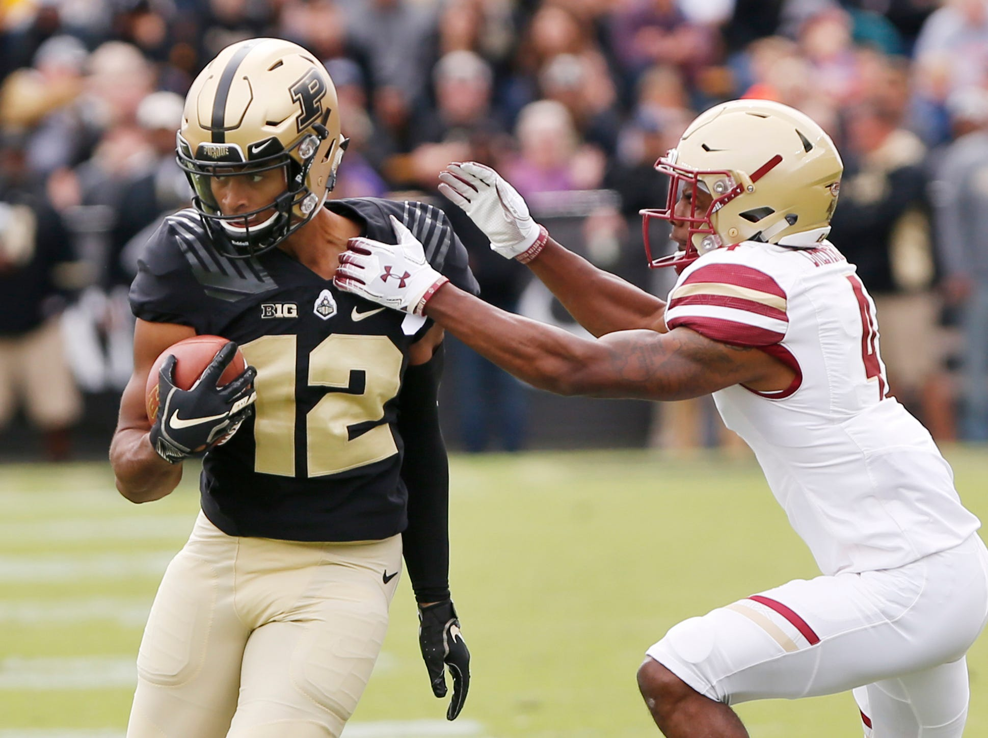 Jared Sparks of Purdue tries to spin free of Hamp Cheevers of Boston College after a pass reception Saturday, September 22, 2018, in Ross-Ade Stadium. Purdue defeated Boston College 30-13.