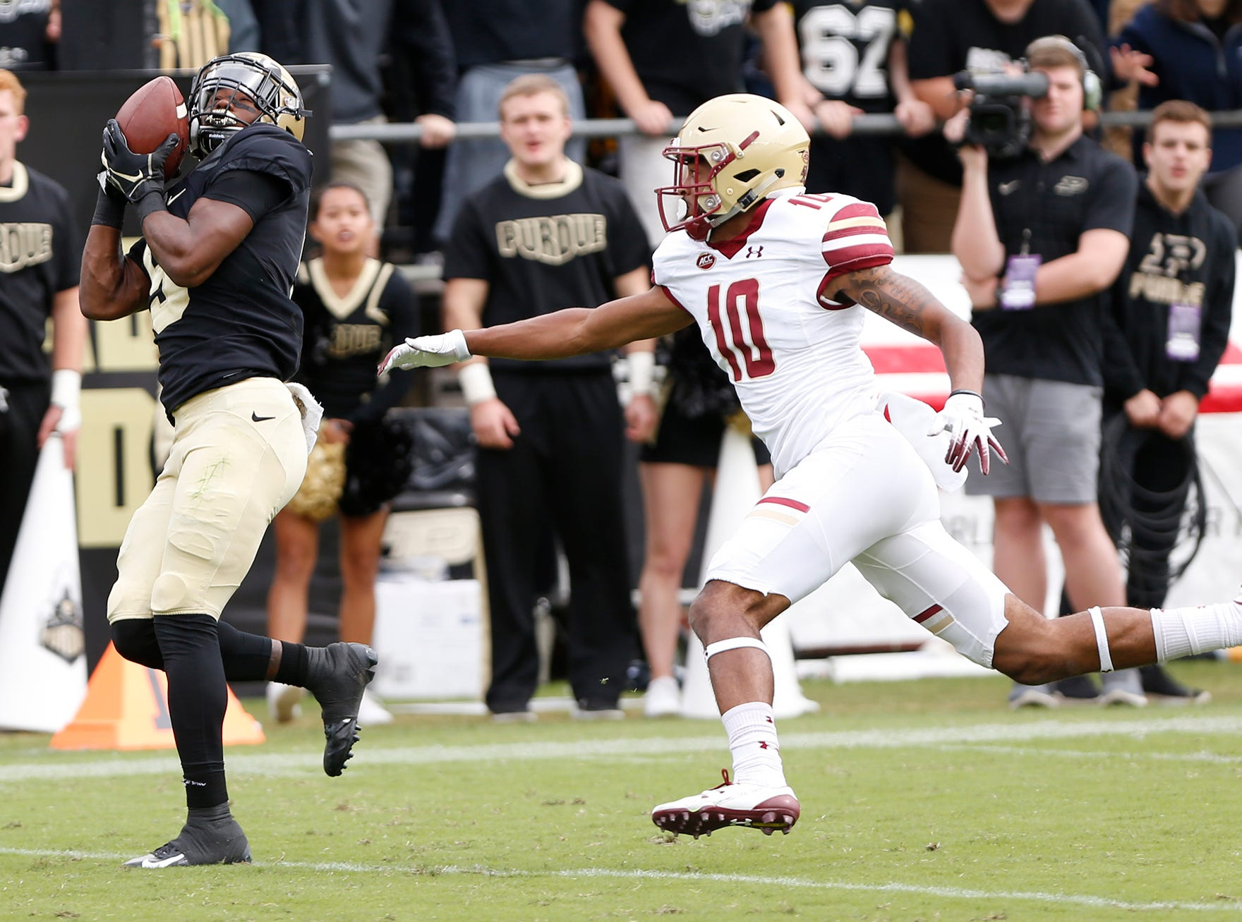 Terry Wright of Purdue with a second half touchdown reception in front of Brandon Sebastian of Boston College Saturday, September 22, 2018, in Ross-Ade Stadium. Purdue defeated Boston College 30-13.