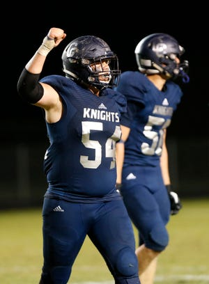 Pete Spencer pumps his fist after Central Catholic forced Rensselaer to turn the ball over on downs late in the fourth quarter Friday, September 21, 2018, in Lafayette. CC defeated Rensselaer 26-21.