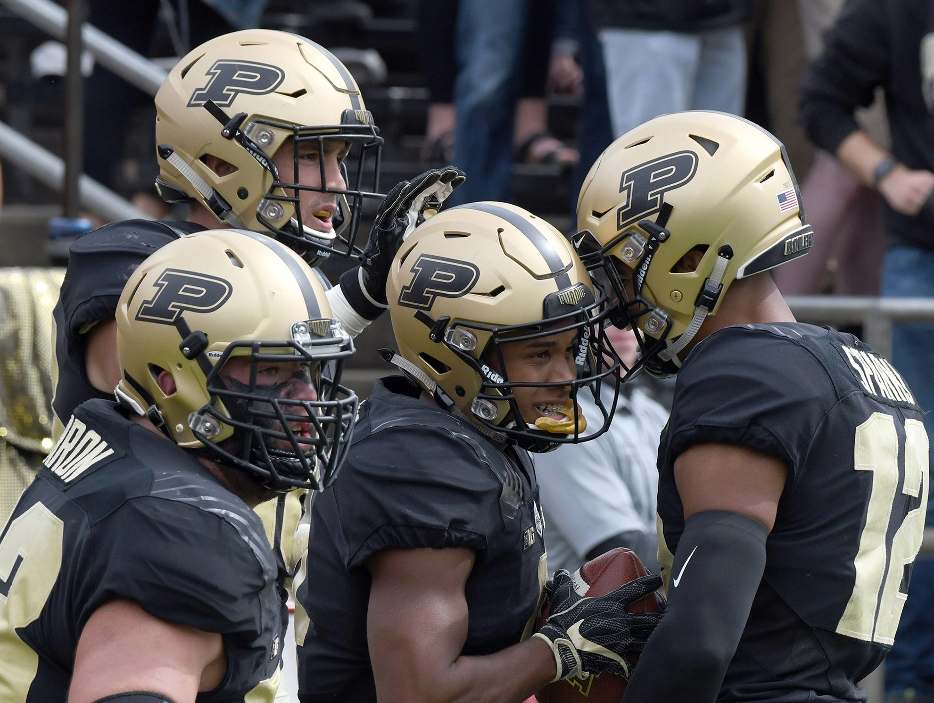 Purdue's Rondale Moore is congratulated after scoring a touchdown in Purdue's 30-13 win in West Lafayette on Saturday September 22, 2018.