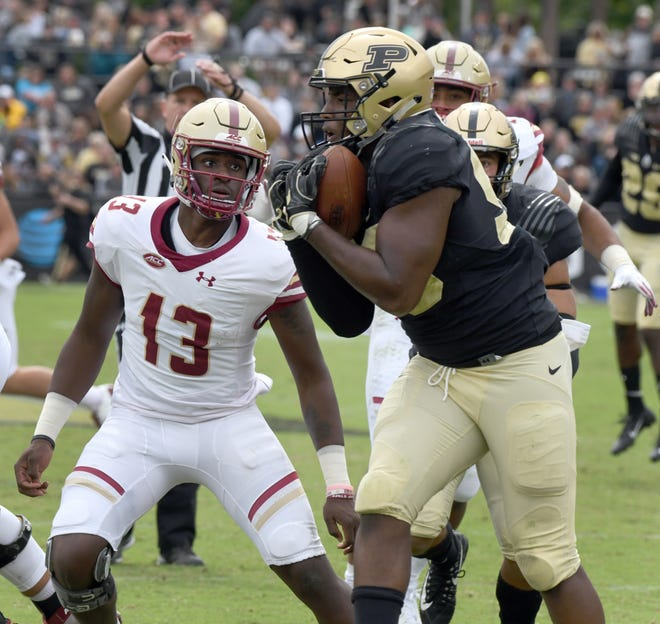 Purdue's Kai Higgins intercepts a tipped pass as BC quarterback Anthony Brown looks on in Purdue's 30-13 win in West Lafayette on Saturday.