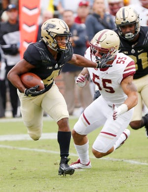Rondale Moore of Purdue with a stiff arm to Isaiah McDuffie of Boston College on a kick return in the first half Saturday, September 22, 2018, in Ross-Ade Stadium.