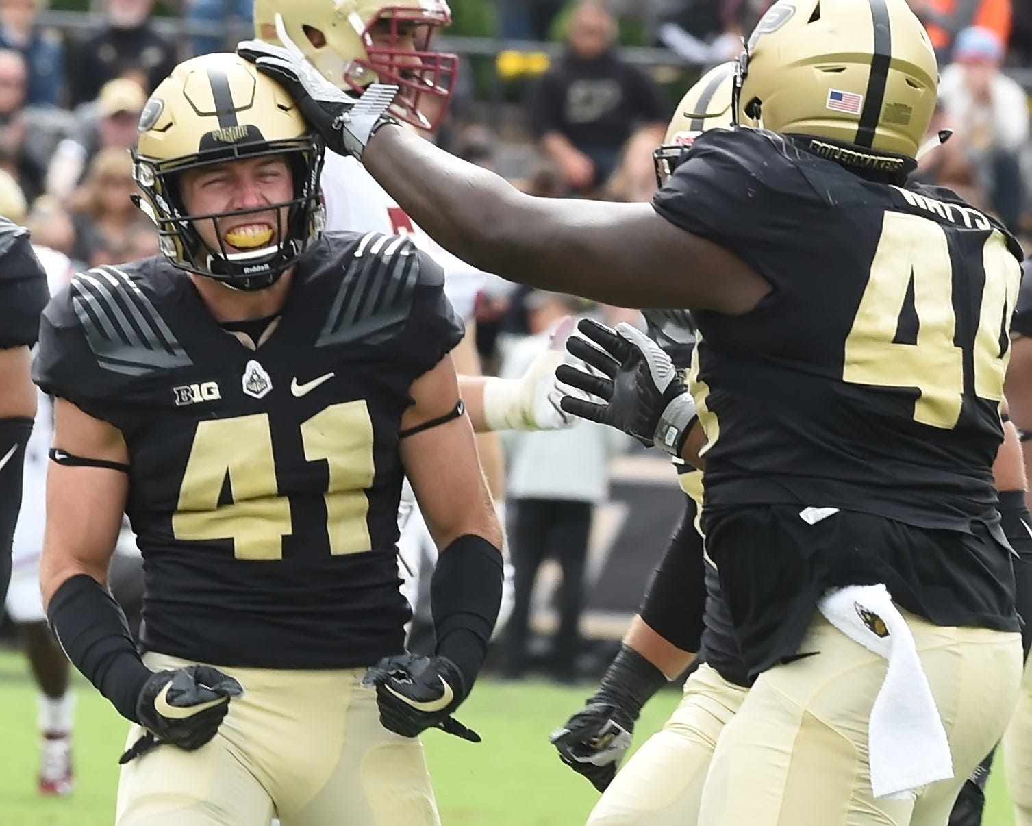 Anthony Watts, right, celebrates with Jacob Thieneman after the safety recorded a sack.