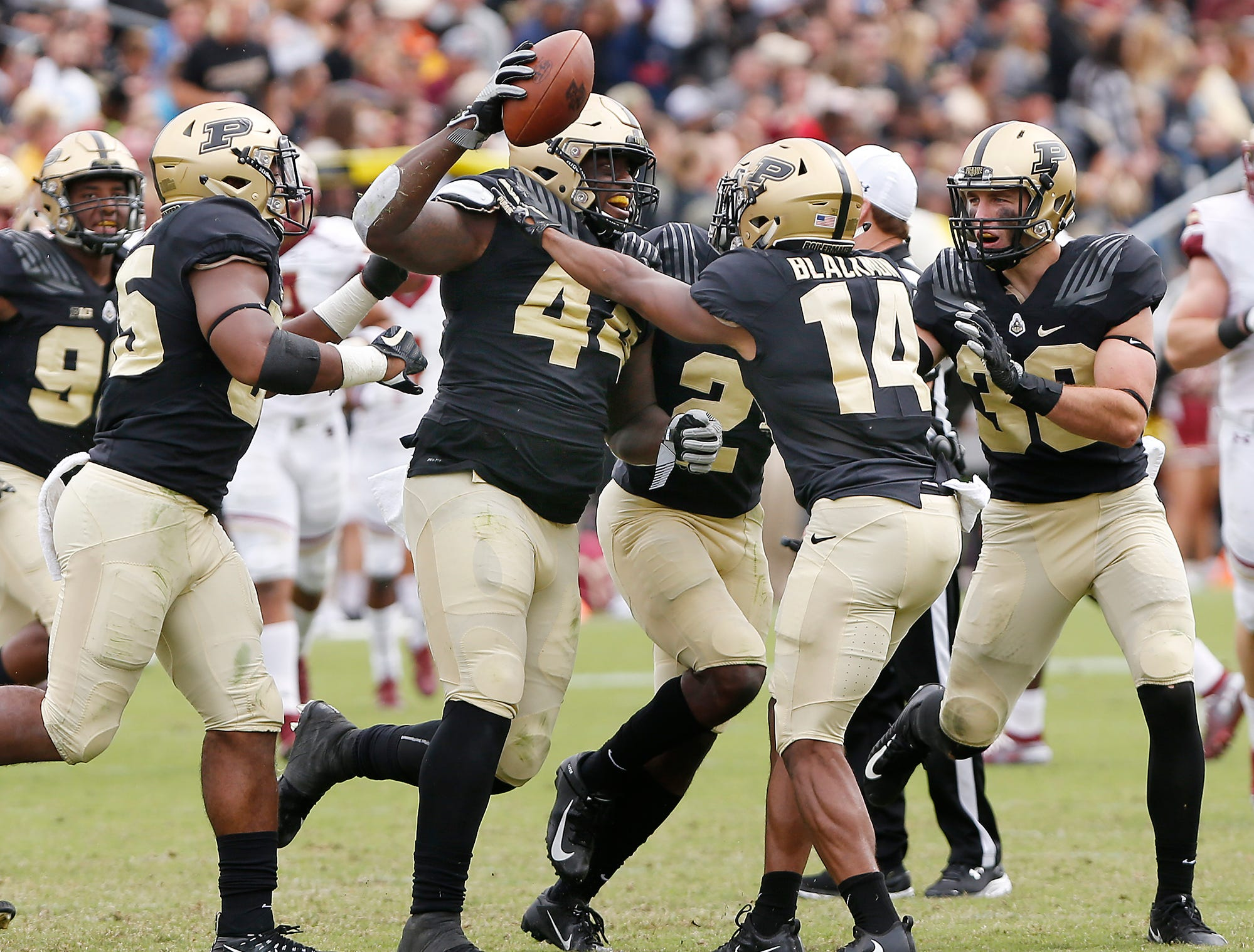 Anthony Watts of Purdue celebrates with teammates after intercepting a Boston College pass that had initially been tipped at the line of scrimmage at 5:42 in the third quarter Saturday, September 22, 2018, in Ross-Ade Stadium. Purdue defeated Boston College 30-13.