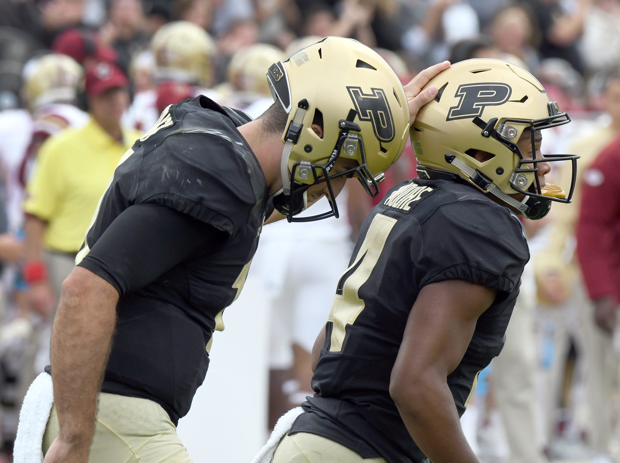 Purdue's David Blough congratulates Rondale Moore after a TD in Purdue's 30-13 win in West Lafayette on Saturday September 22, 2018.