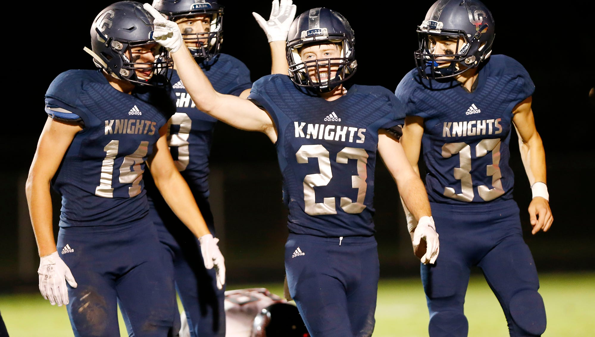 Daniel Roach (23) celebrates with his Central Catholic teammates after intercepting a Rensselaer pass in the second quarter Friday, September 21, 2018, in Lafayette.