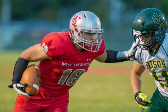West Lafayette's Sage Hood finishes off a run strong against Benton Central.